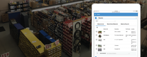 screenshot of Cityworks Storeroom software on a warehouse background