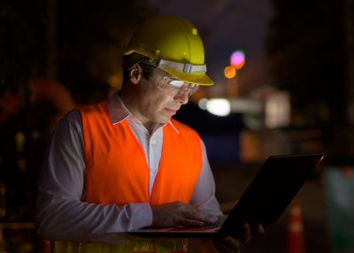 Portrait of handsome Persian man construction worker on the construction site at night horizontal shot