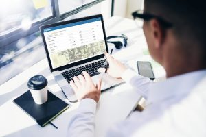 Man viewing business permit government software on laptop