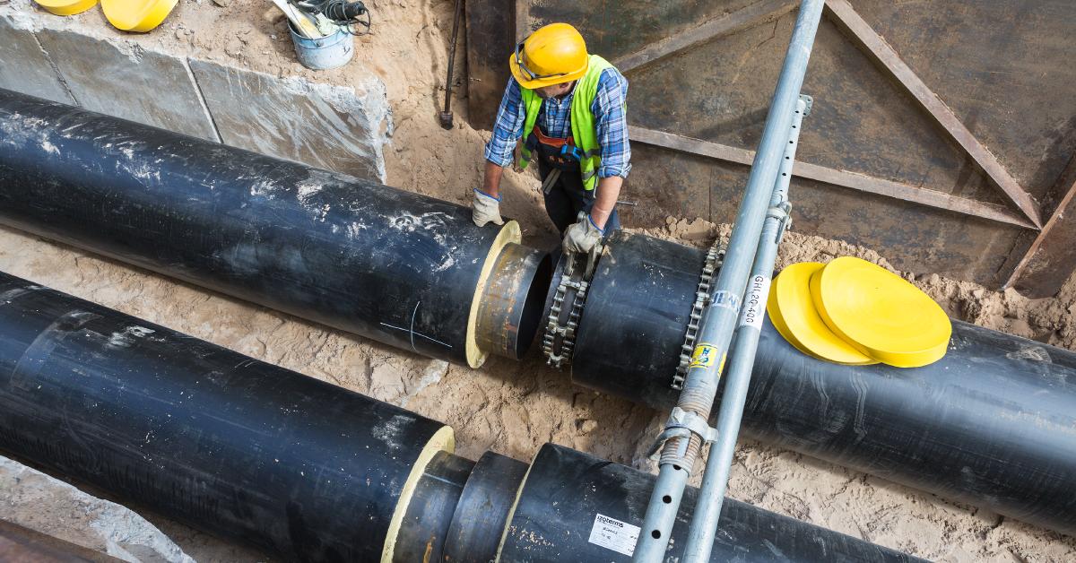 construction worker installing water infrastructure